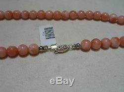 Beautiful Vintage 7.5mm Coral Bead Necklace 18 inches with 14 karat Gold Clasp