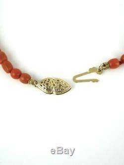 Vintage natural Momo coral bead necklace with carved monkey and dog heads 1970s
